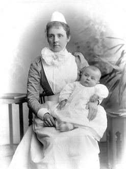 A NURSEMAID WITH A BABY