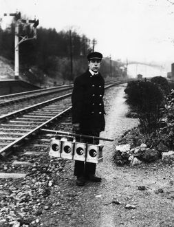 Signal lamp man servicing signal lanterns, c1930s