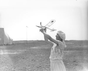 Woman with model aeroplane
