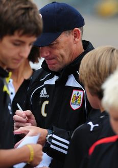 Bristol City Manager, Steve Coppell signs autographs for the academy players
