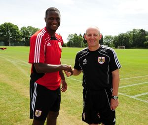 Bristol City New signing Kalifa Cisse with Bristol City Manager, Steve Coppell
