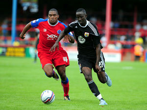 Bristol City's Albert Adomah battles for the ball with Aldershots Manny Panther
