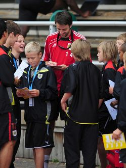 Bristol City's Cole Skuse signs autographs