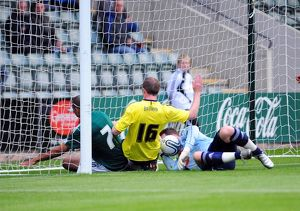 Bristol City's David Clarkson see's his effort cleared off the line