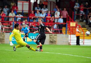 Bristol City's David Clarkson sees his shot saved by Aldershots Jamie Young