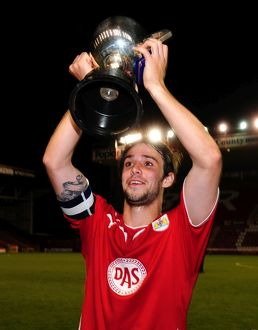 Bristol Citys Frankie Artus lifts the trophy
