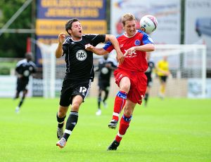 Bristol City's Ivan Sproule battles for the ball with Aldershots Jamie Vincent