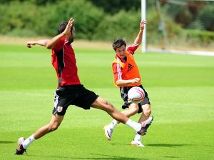 Bristol City's Ivan Sproule challenges for the ball with Bristol City's Liam