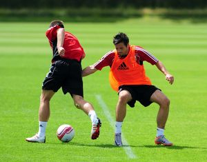 Bristol City's Ivan Sproule challenges for the ball with Bristol City's Gavin