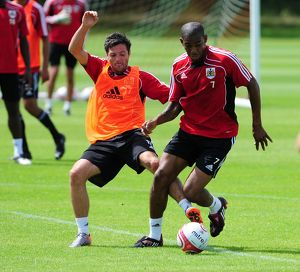 Bristol City's Ivan Sproule challenges for the ball with Bristol City's Marvin