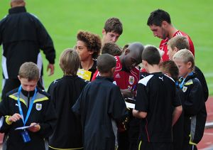 Bristol City's Jamal Camplbell-Ryce and Bristol City's Bradley Orr sign autographs