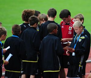 Bristol City's Joe Edwards signs autographs