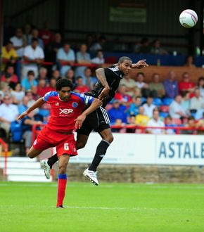Bristol City's Marvin Elliott challenges for the ariel ball with Aldershots Anthony