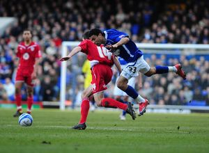 Carlos Edwards tussles with Cole Skuse