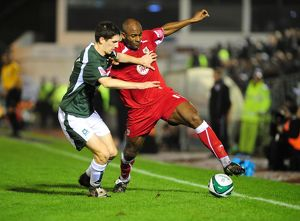 Dele Adebola battles with Craig Cathcart