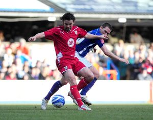 Paul Hartley tussles with David Healey