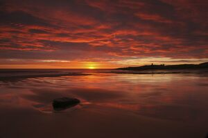 Dunstanburgh's dramatic sunrise