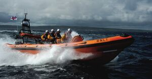 Red Bay Altantic 85 inshore lifeboat Geoffrey Charles B-843. Lifeboat moving from left to right at speed, four crew