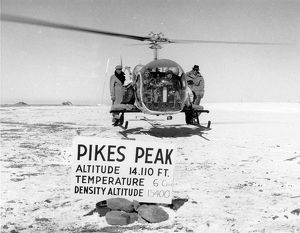 Bell Model 47G-3 hovers atop Pikes Peak with pilot and f?
