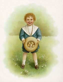 BOY IN GARDEN WITH EGGS
