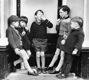 Children with ice lollies on a Balham street, SW London