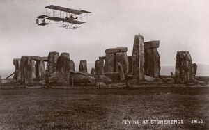 An early aircraft flying over Stonehenge, Wiltshire