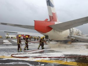Fire crews attend the aftermath of a plane crash