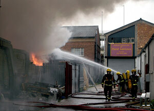Firefighters at scene of commercial premises fire