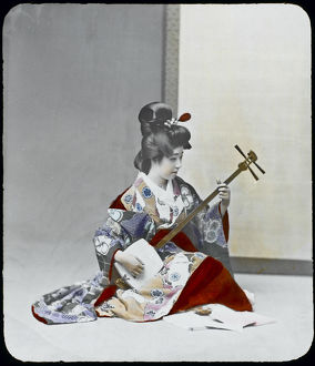 GEISHA PLAYING SHAMISEN