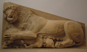Lioness attacking a bull. Relief. Probably part of the origi