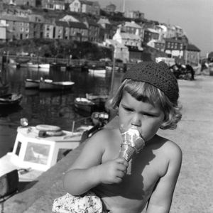 Little girl eating an ice cream, Cornwall