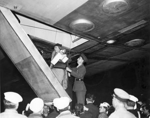 Miss Mary Day Winn of New York is helped aboard LZ 129 H?