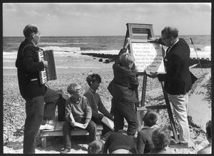 Religious service being held on a beach