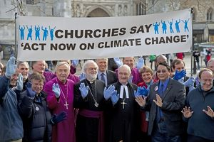 Church leaders with banner outside Houses of Parliament