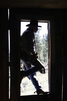 Cowboy - silhouetted in door frame