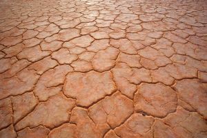 Dried-up earth - the hot sun in the Simpson Desert area blazes down onto the earth