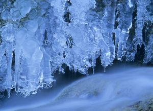 Icicles - bizarre frozen water at waterfall in winter