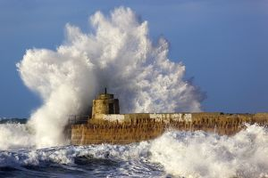 Portreath - wave breaks over pier in storm