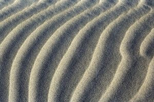 Sand Dune - close-up of sand ripples of white sand dunes at Whaririki Beach