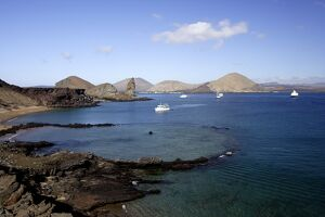 View of coastline and incoming boats from Bartolome Island, Galapagos Islands