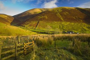 Scotland, Scottish Borders, Liddesdale. Farm gate and undulating scenery near Liddesdale