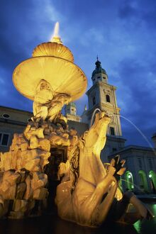 The 17th century fountain in the Residenzplatz illuminated by night, Salzburg
