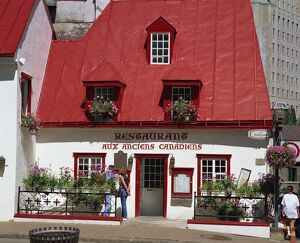A 17th century house with red roof, now a restaurant, in Quebec City, Quebec
