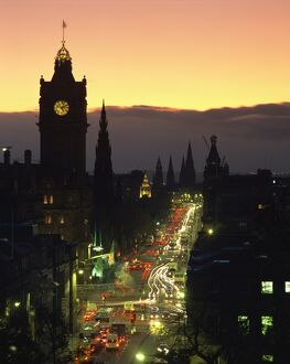 Aerial view over Princes Street at dusk, including the silhouetted Waverley Hotel