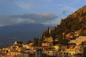Aerial view over town of Taormina at dusk