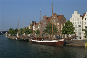 Boats with tall masts on the waterfront of Lubeck City