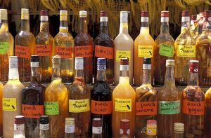 Bottles of local rum drinks at Le Diamant village