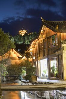 canalside buildings dusk lijiang unesco world