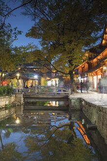 canalside restaurant dusk lijiang unesco world