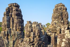Carved stone faces at Prasat Bayon temple ruins, Angkor Thom, UNESCO World Heritage Site